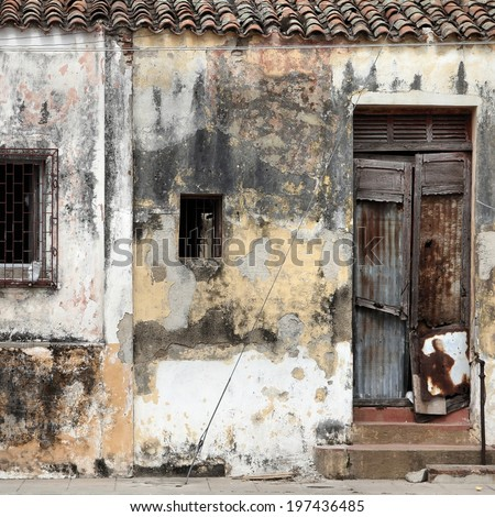 Camaguey, Cuba - old town listed on UNESCO World Heritage List. Urban decay. Square composition. - stock photo