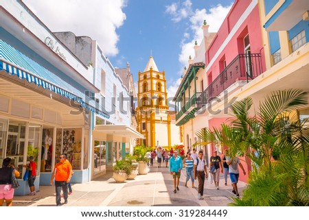 CAMAGUEY, CUBA - SEPTEMBER 4, 2015: Street view of UNESCO heritage city centre, walking boulevard with stores - stock photo
