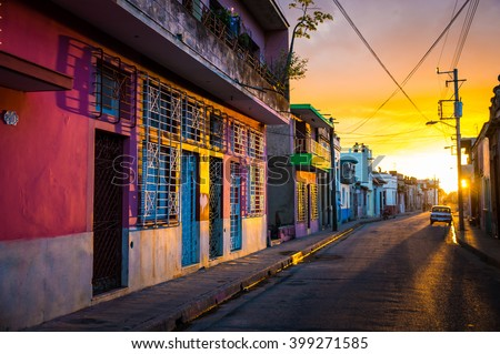 Camaguey, CUBA - The warm sunset light shines on the empty streets of the world heritage city centre in the Cuban city of Camaguey, an unique latin american city in the Caribbean -  January 2016 - stock photo