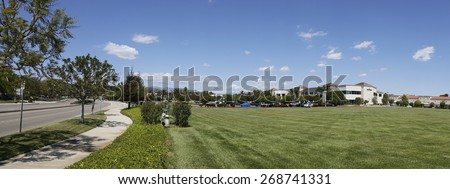 CAMARILLO, CA - APRIL 8, 2015: Semtech corporate headquarter office across perfectly manicured green grassy field in Camarillo, California; Neighborhood panorama - stock photo
