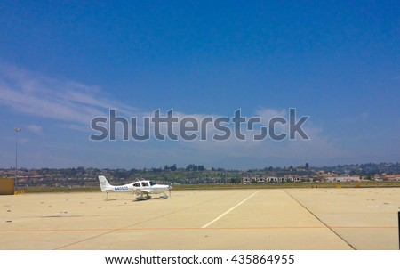 CAMARILLO, CA - MAY 28, 2014: Light single engine small aircraft Cirrus SR22 parked at public Camarillo reliever airport (also known as KCMA, CMA), Ventura county, Southern California - stock photo