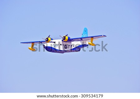 """CAMARILLO/CALIFORNIA - AUGUST 23, 2015: 1952 Grumman HU-16B fixed wing twin engine known as """"Albatross"""" demonstrates its flying agility at Wings over Camarillo Air Show in Camarillo, California USA - stock photo"""