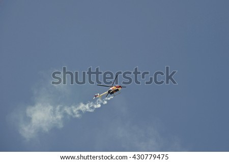 CAMARILLO/CALIFORNIA - AUGUST 22, 2015: Pilot Chuck Aaron performs aerobatics in the Red Bull Helicopter (MBB Bo 105) at Wings Over Camarillo Airshow in Camarillo, California USA