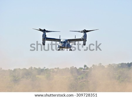 CAMARILLO/CALIFORNIA - AUGUST 23, 2015: USMC MV-22 Osprey, an American multi-mission tiltrotor aircraft demonstrates its flying agility at Wings Over Camarillo Airshow in Camarillo, California USA  - stock photo
