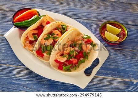 Camaron shrimp tacos mexican food on blue wood table - stock photo