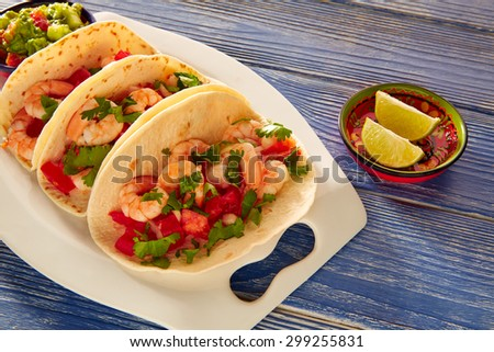 Camaron shrimp tacos mexican food on blue wood table - stock photo