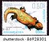 CAMBODIA - CIRCA 1987:  A stamp printed in Cambodia shows a Yellow/orange Bell's Dabb Lizard, a spiny-tailed lizard, Uromastyx acanthinura or  Uromastyx acanthinurus, circa 1987. - stock photo