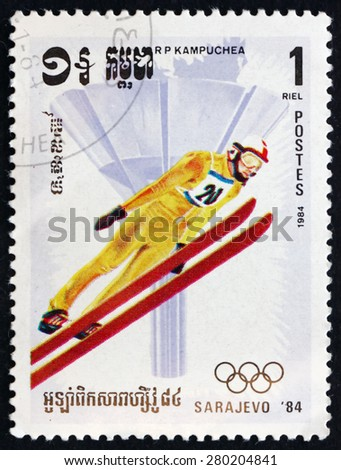CAMBODIA - CIRCA 1984: a stamp printed in Cambodia shows Ski Jumping, 1984 Winter Olympics, Sarajevo, circa 1984 - stock photo