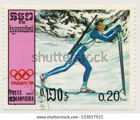CAMBODIA - CIRCA 1987: A stamp printed in Kampuchea, shows Olympic games Calgary 1988, skier, circa 1987