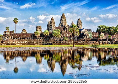 Cambodia landmark wallpaper - Angkor Wat with reflection in water - stock photo