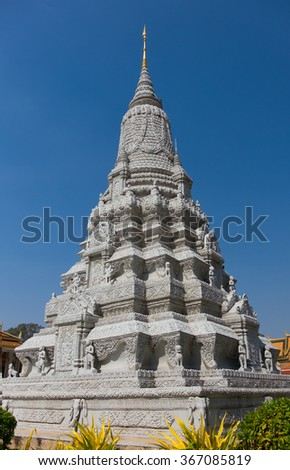 CAMBODIA, PHNOM PENH - JANUARY 2015: Stupa of Ang Duong at the Silver Pagoda on January 13, 2015 in Phnom Penh. Stupa of His Majesty Ang Duong was built in 1908 and contains his cremated ashes - stock photo