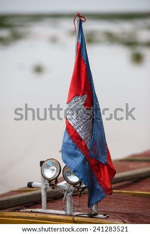 Cambodia waving flag on the boat - stock photo