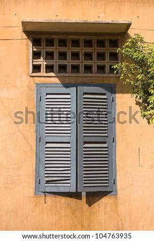 Cambodian style windows in Phnom Penh . - stock photo