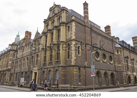 Cambridge, England - July 7, 2016: Architecture of ancient British buildings at the intersection of Tennis Court Road in Cambridge, England.