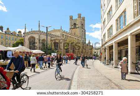 CAMBRIDGE, ENGLAND - MAY 28: Market square and St. Mary's church in Cambridge on May 28, 2015 in Cambridge - stock photo