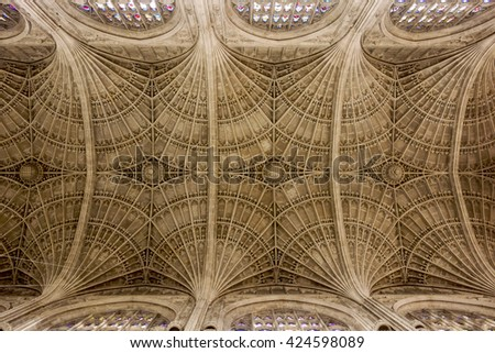 CAMBRIDGE, ENGLAND - MAY 9, 2015: The geometric pattern of a ceiling  on a cathedral in Cambridge, England shows the attention to architectural detail in the construction. - stock photo
