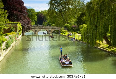 CAMBRIDGE, ENGLAND - MAY 28: Trinity College, University of Cambridge. Punting on the River Cam on May 28, 2015 in Cambridge - stock photo