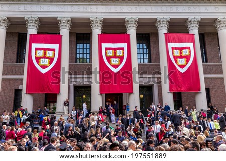 CAMBRIDGE, MA - MAY 29: Students of Harvard University gather for their graduation ceremonies on Commencement Day on May 29, 2014 in Cambridge, MA. - stock photo