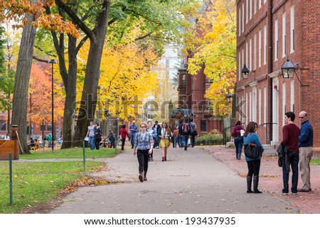 CAMBRIDGE, MA, USA - NOVEMBER 2, 2013: Harvard Yard, old heart of Harvard University campus, on a beautiful Fall day in Cambridge, MA, USA on November 2, 2013. - stock photo