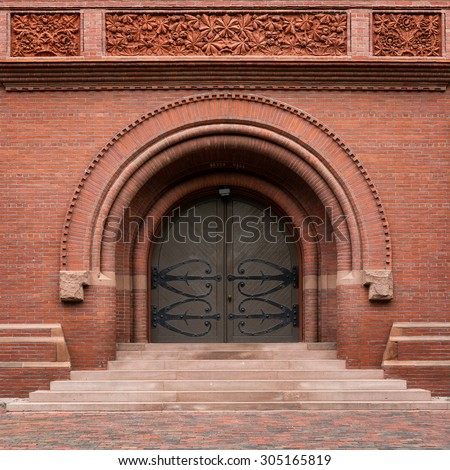 CAMBRIDGE, MASSACHUSETTS - JULY 26: Entrance to Sever Hall in the Harvard Yard on the campus of Harvard University on July 26, 2015 in Cambridge, Massachusetts - stock photo