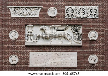 CAMBRIDGE, MASSACHUSETTS - JULY 26: Ornaments outside Robinson Hall on the Sever quadrangle on the campus of Harvard University on July 26, 2015 in Cambridge, Massachusetts - stock photo