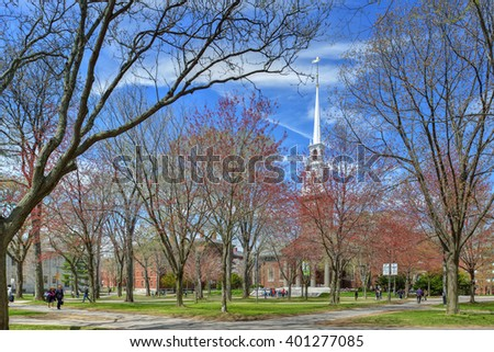 Cambridge - May 1: Students, tourists and spring colors fill Harvard Yard on May 1, 2015. Harvard University is a world-leading academic institution and a major tourist destination in Cambridge, MA. - stock photo