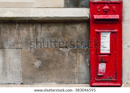 CAMBRIDGE, UNITED KINGDOM - FEBRUARY 27, 2016: A British Post Box set into the walls of a University of Cambridge building.