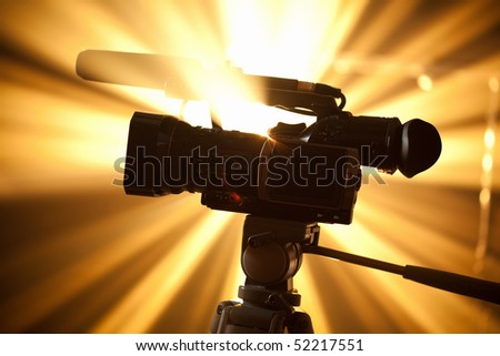 camcorder against the shiny background - stock photo