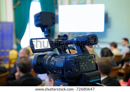 Camcorder at a conference. - stock photo