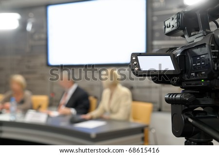 Camcorder at a news conference. - stock photo