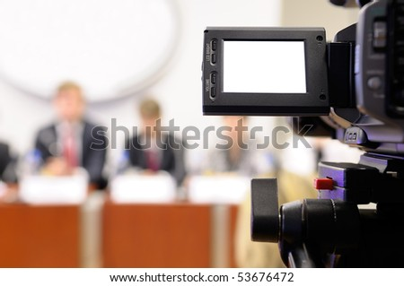 Camcorder at a press conference. - stock photo
