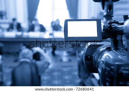 Camcorder screen at a conference. - stock photo