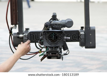 camcorder, video camera on the crane, camcorder on the crane  - stock photo
