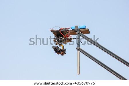 Camcorder work. The camera on the operator crane. - stock photo