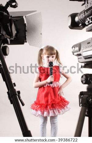camcorders shooting little girl - stock photo