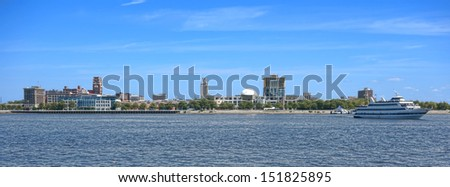 Camden New Jersey waterfront cityscape wide scenic view panorama with cruise boat from across the Delaware River from Philadelphia - stock photo