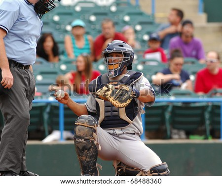 CAMDEN, NJ - AUGUST 15: Bridgeport Bluefish catcher Luis Rodriguez (r) prepares to throw the ball back to the pitcher during an Atlantic League baseball game August 15, 2010 in Camden, NJ. - stock photo