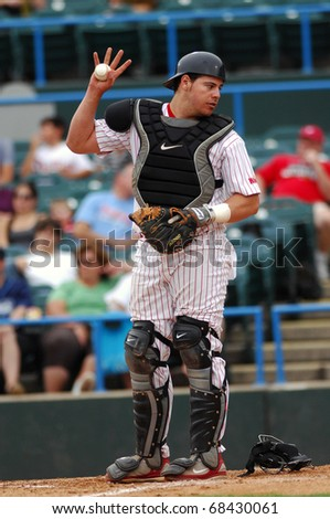 CAMDEN, NJ - AUGUST 15: Camden Riversharks catcher Raul Pardon asks for time out after a close play at the plate during an Atlantic League game August 15, 2010 in Camden, NJ. - stock photo