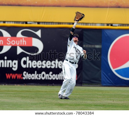 CAMDEN, NJ - MAY 26: Charlotte 49'er outfielder Shane Brown prepares to catch a fly ball during an Atlantic Ten baseball tournament game against Charlotte on May 26, 2011 in Camden, NJ. - stock photo