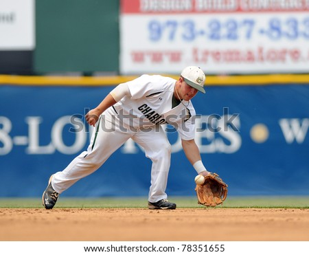 CAMDEN, NJ - MAY 26: Charlotte infielder Justin Roland fields a ground ball during an Atlantic Ten baseball tournament game against Richmond May 26, 2011 in Camden, NJ. - stock photo