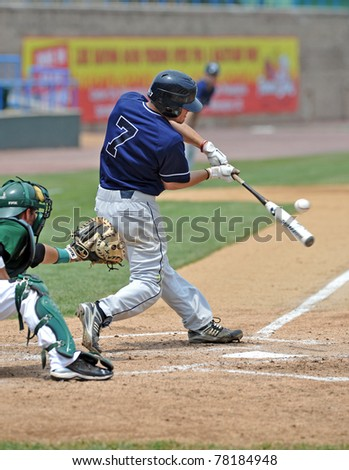 CAMDEN, NJ - MAY 27: Rhode Island infielder Mike LeBel (#7) connects with a pitch during an Atlantic 10 Baseball tournament game against Charlotte on May 27, 2011 in Camden, NJ. - stock photo