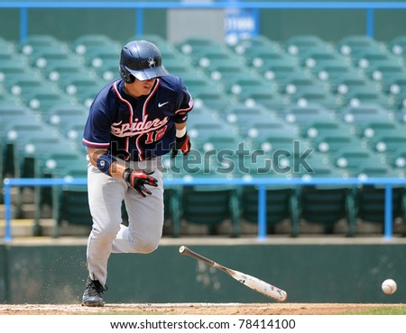 CAMDEN, NJ - MAY 26: Richmond batter Bryan Conway digs for first base after a 'swinging bunt' during an Atlantic Ten baseball tournament game against Charlotte on May 26, 2011 in Camden, NJ. - stock photo