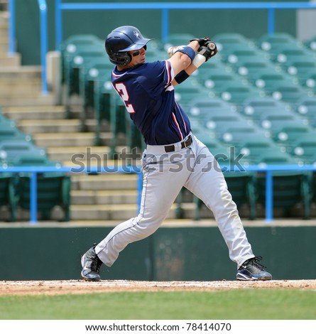 CAMDEN, NJ - MAY 26: Richmond batter Bryan Conway follows through on his swing during an Atlantic Ten baseball tournament game against Charlotte on May 26, 2011 in Camden, NJ. - stock photo