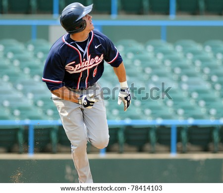 CAMDEN, NJ - MAY 26: Richmond batter Phil Ruzbarsky watches a ball he has just hit as he runs to frist base during an Atlantic Ten baseball tournament game against Charlotte on May 26, 2011 in Camden, NJ - stock photo