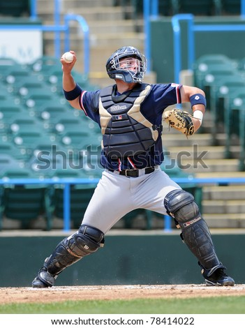 CAMDEN, NJ - MAY 26: Richmond catcher Bryan Conway throws the ball to second base on defense during an Atlantic Ten baseball tournament game against Charlotte on May 26, 2011 in Camden, NJ. - stock photo