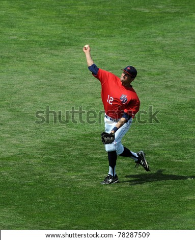 CAMDEN, NJ - MAY 25: University of Dayton outfielder Mike Coughlin throws the ball back into the infield during pregame prior to an Atlantic 10 tournament game on May 25, 2011 in Camden, NJ. - stock photo