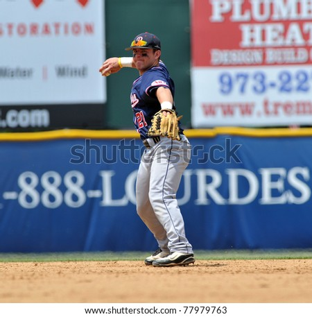 CAMDEN, NJ - MAY 25: University of Richmond second baseman Adam Forrer throws the ball to first during an opening round game in the Atlantic 10 Baseball Championships on May 25, 2011 in Camden, NJ. - stock photo