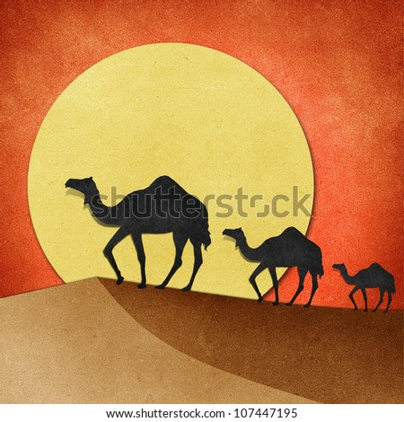 Camel and pyramid on desert Recycled Papercraft - stock photo