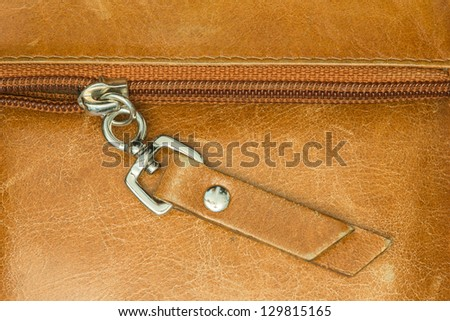 Camel colored leather texture with zipper background - stock photo
