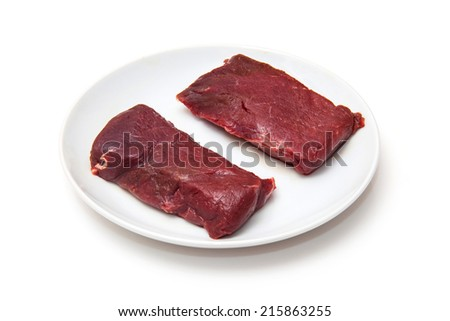 Camel meat steaks uncooked isolated on a white studio background. - stock photo